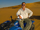 Hilmar quadbiking in the dunes by Blaine Harrington, Travel Photographer