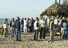 Conference clients enjoy sundowers at a beach bar in Swakopmund